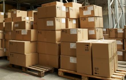picture of stacked boxes in warehouse