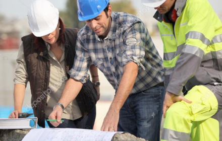 construction workers looking at blueprints