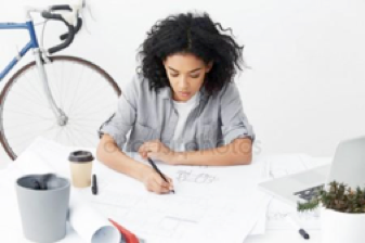 woman contemplating over papers